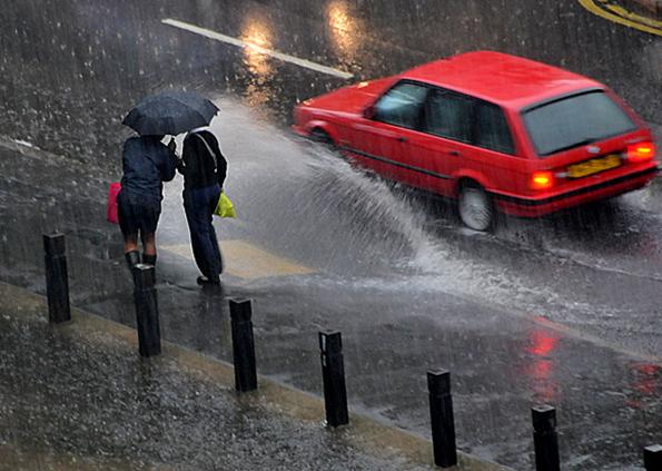 Car splashing pedestrians
