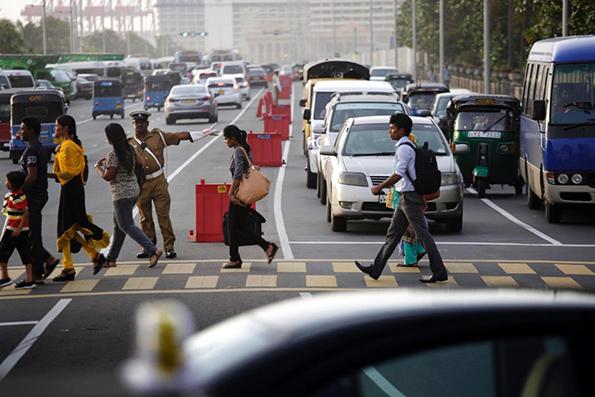 Pedestrians crossing in singapore